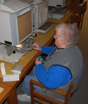 woman at microfilm reader